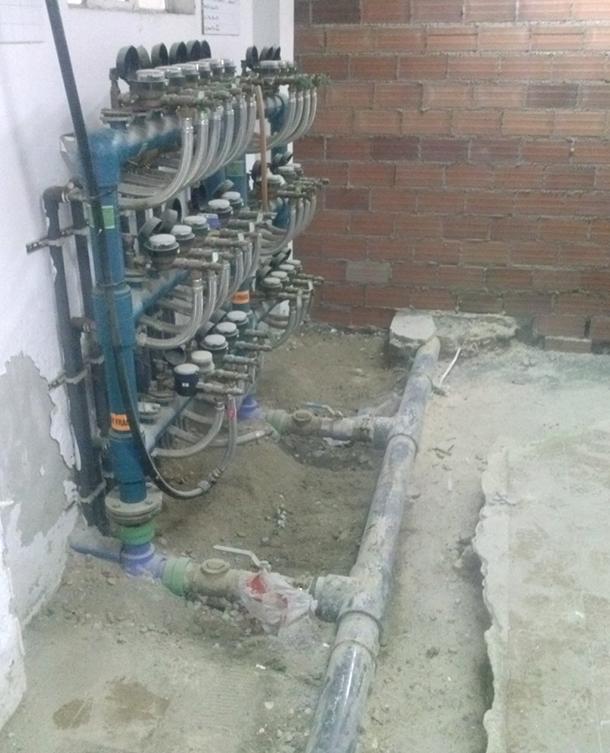 Desarrolla-edificio-viviendas-suelo-radiante-caldera-gas-colector_610px